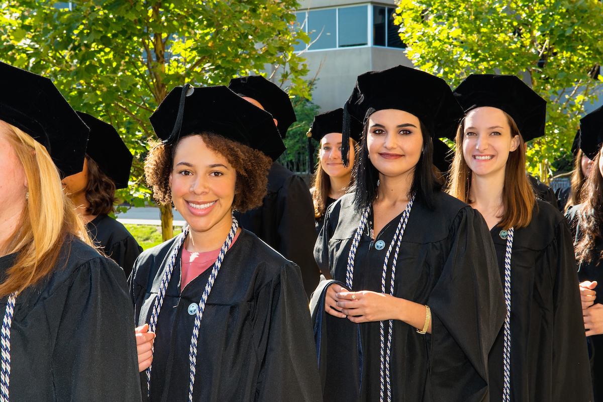 Graduates from the College of Health Sciences take part in a commencement ceremony at Midwestern University on August 23, 2017.