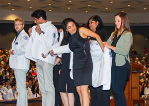 Chicago College of Pharmacy students receive their clinical white coats
