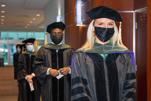 College of Pharmacy, Downers Grove graduates participate in a special graduation convocation at Midwestern University.